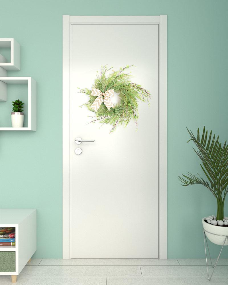 Using wreath for decorating a bedroom door