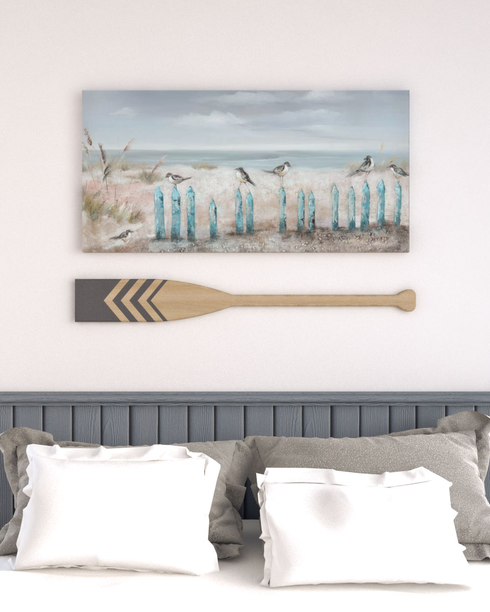 Coastal style above bed wall decor