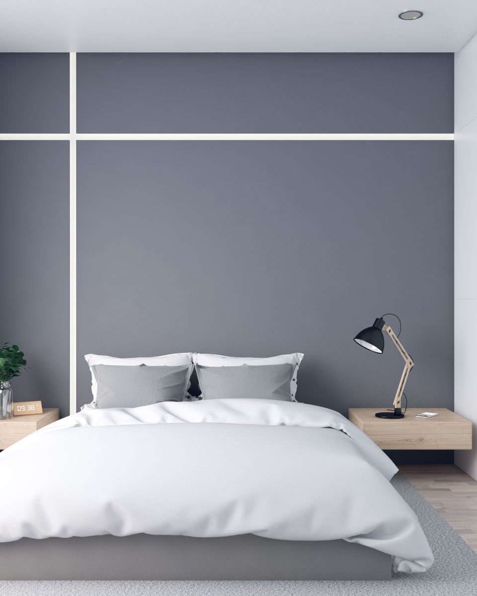 Simple elegant bedroom with dark grey accent wall