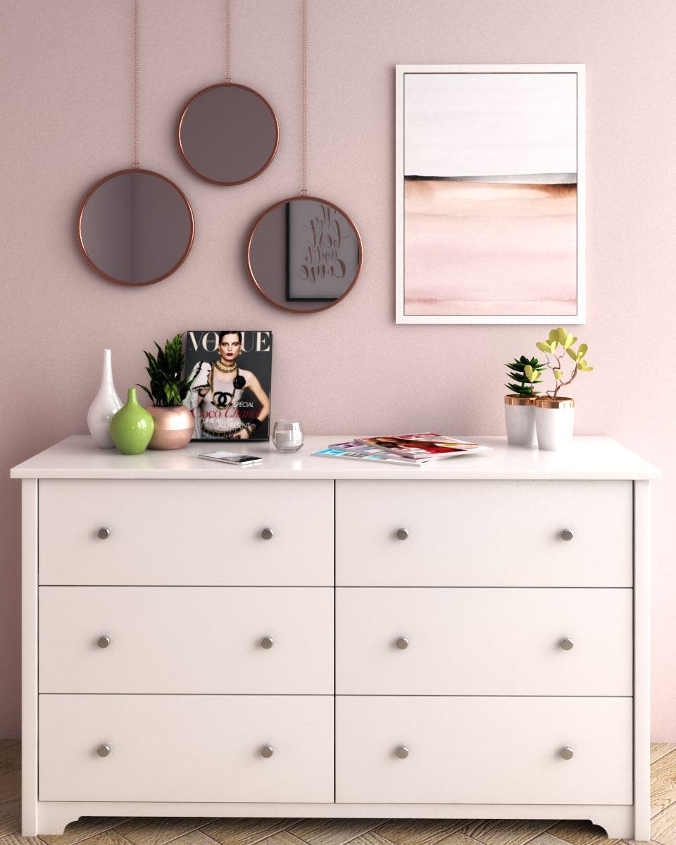 Simple glamorous pink wall decor using mirror and wall art
