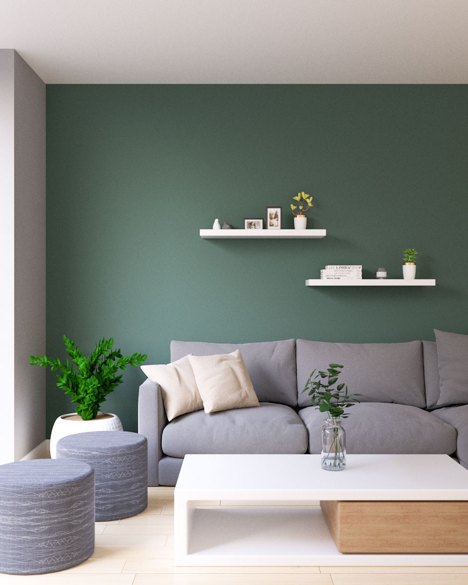 Sage green accent wall with gray sectional sofa