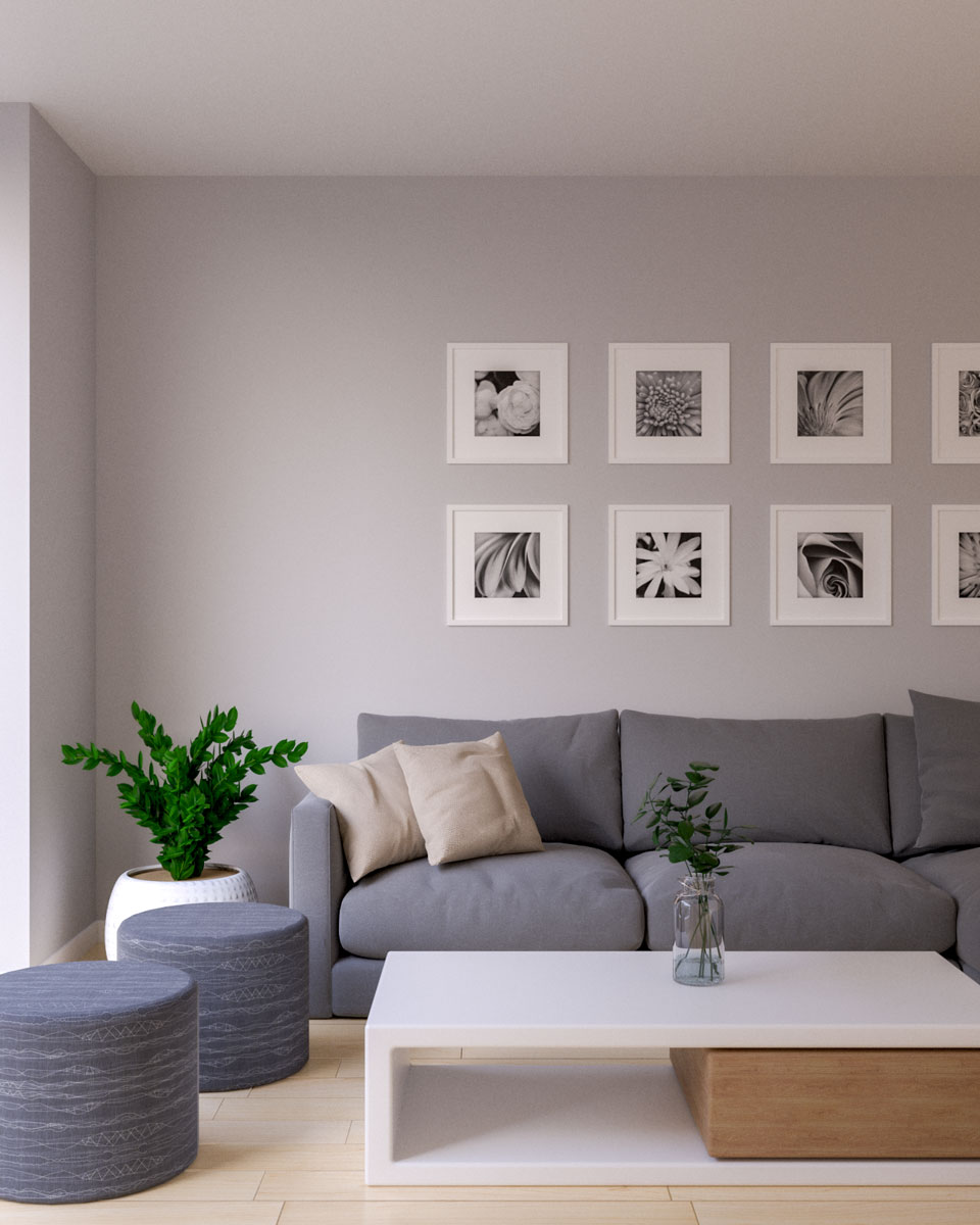 Light gray wall with dark gray couch