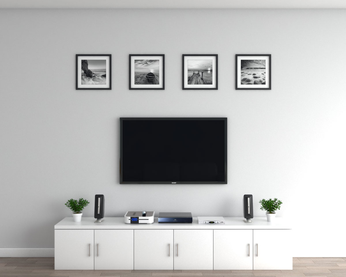Decorate empty space above TV using a set of wall art