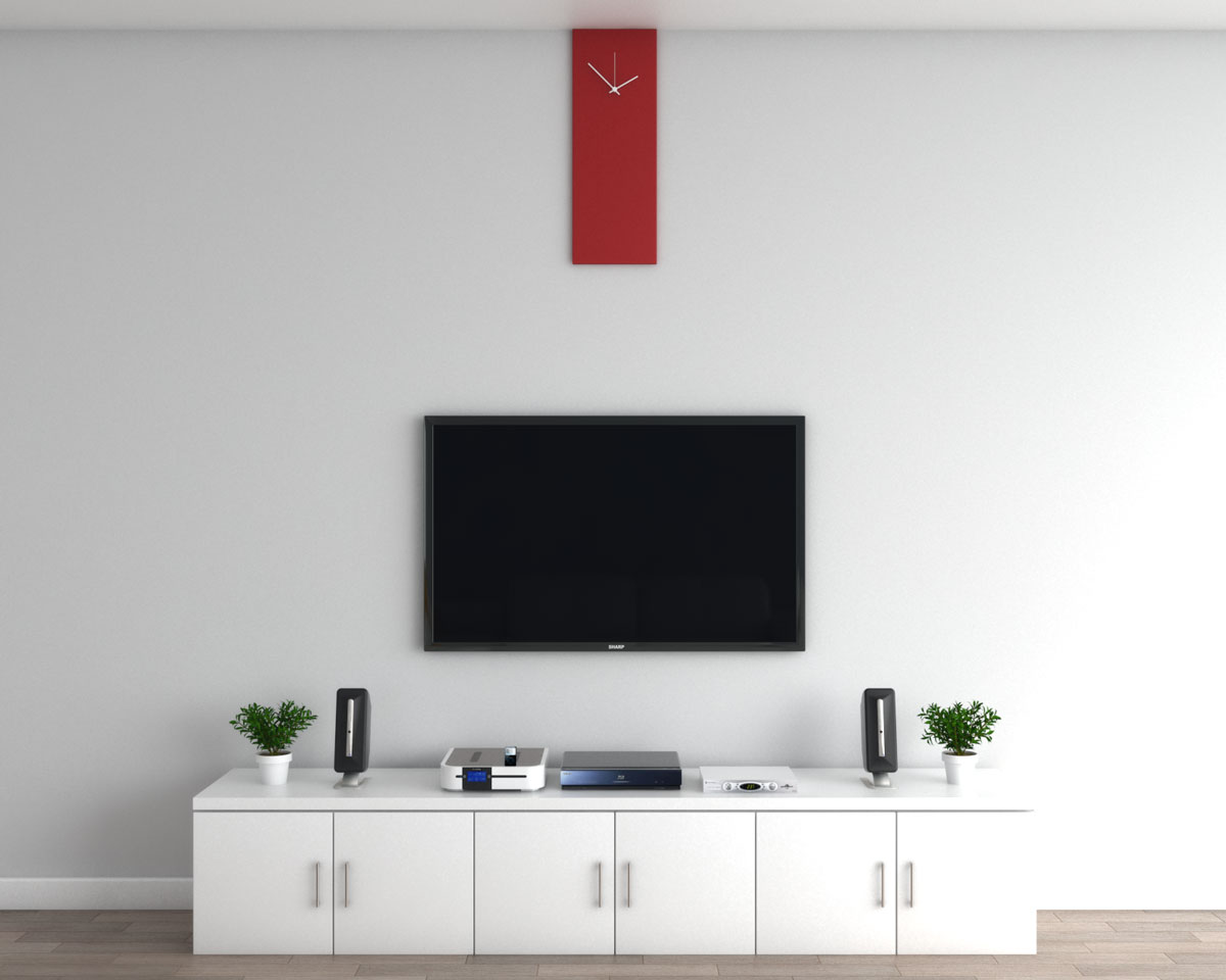 Decorative red wall clock above TV