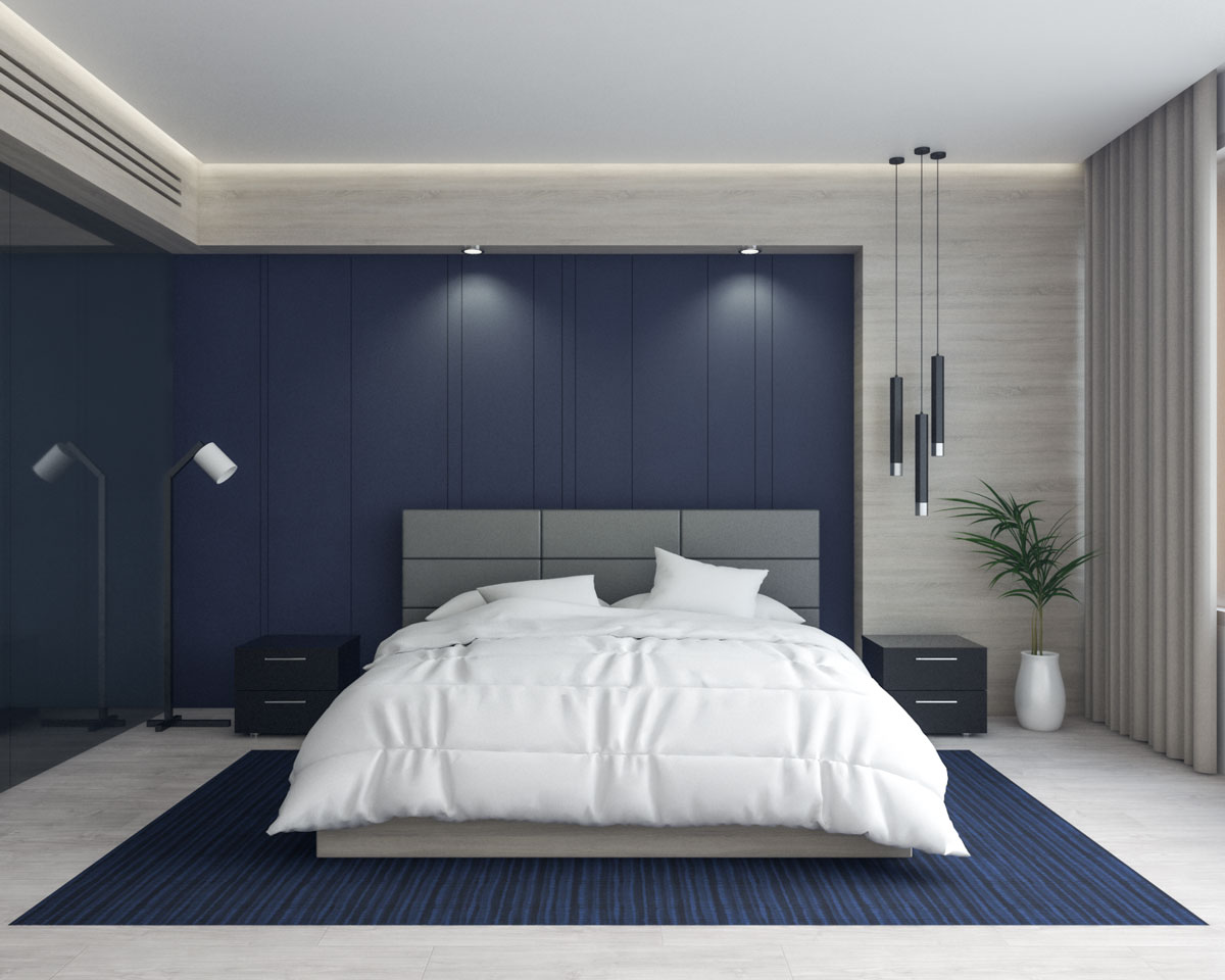 Contemporary master bedroom with dark blue accent wall