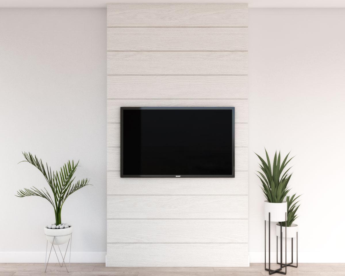 Modern white wood panel behind TV