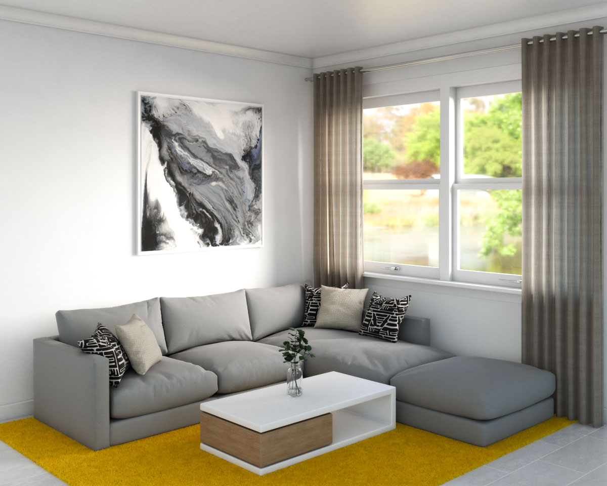 Bright yellow rug with gray couch
