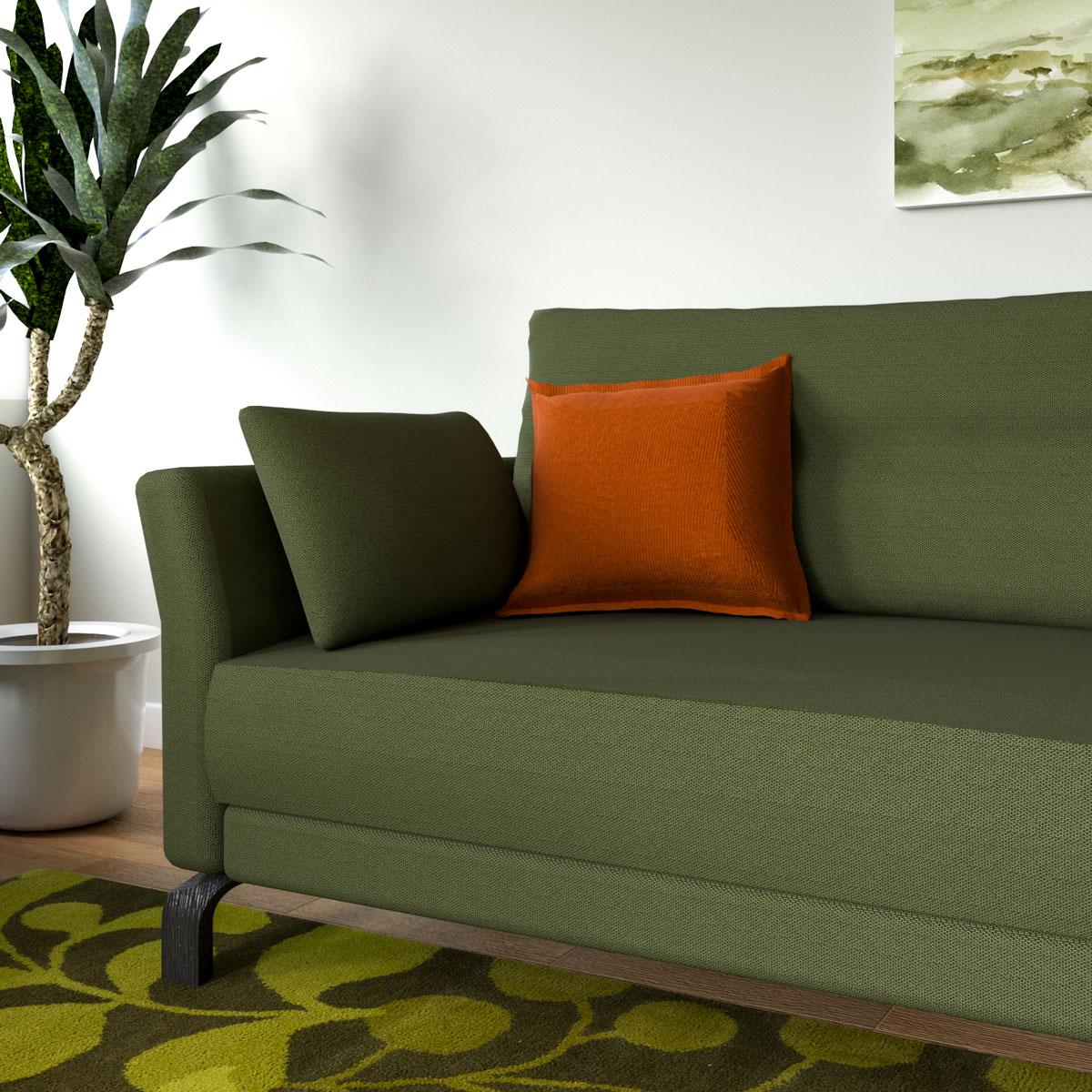 Orange throw pillow in olive green sofa