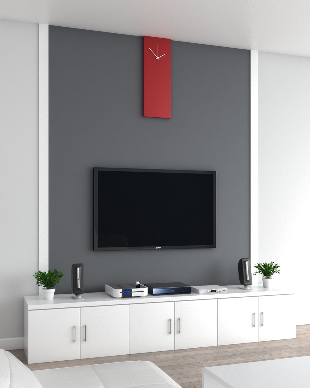 Framed gray accent wall with red clock behind a tv