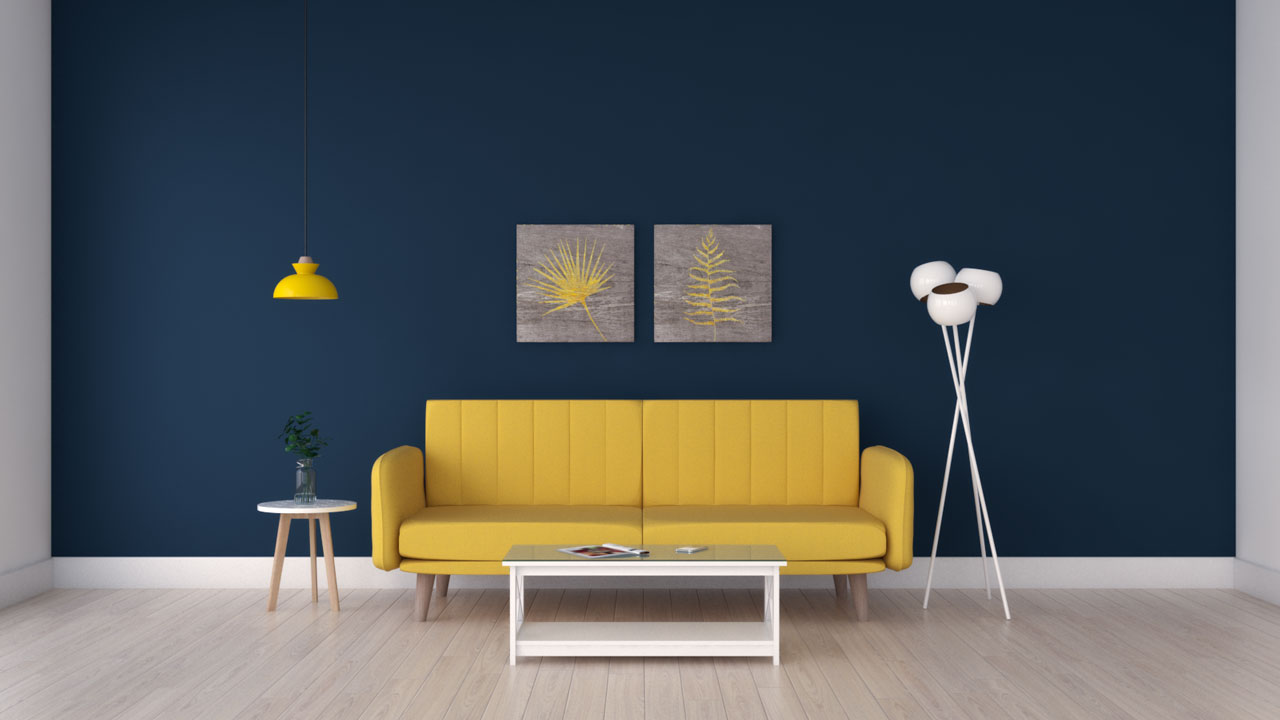 Yellow couch with navy blue accent wall