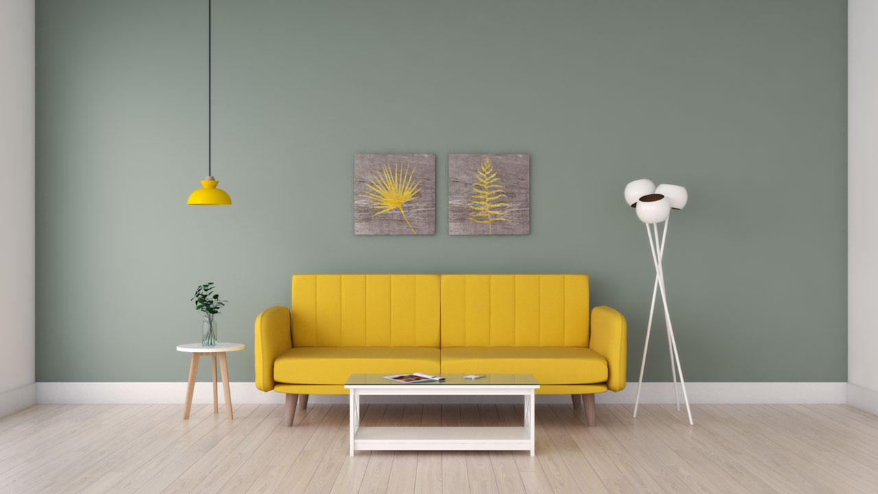 Yellow couch with pale green wall