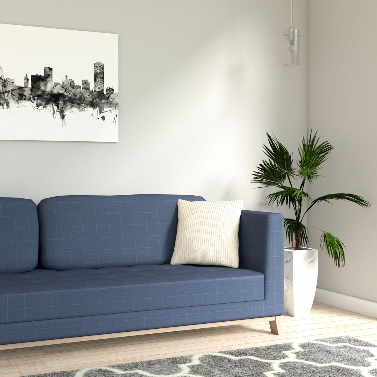 Velvet corduroy cream stripe throw pillow with blue couch