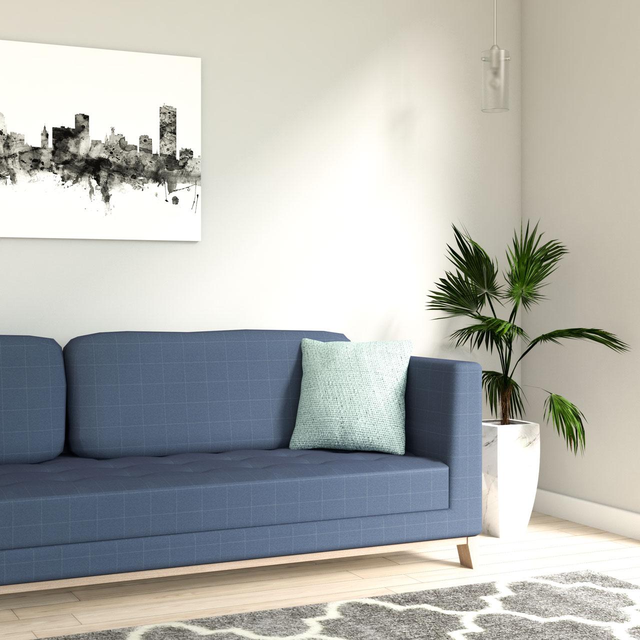 Light blue throw pillow with blue sofa