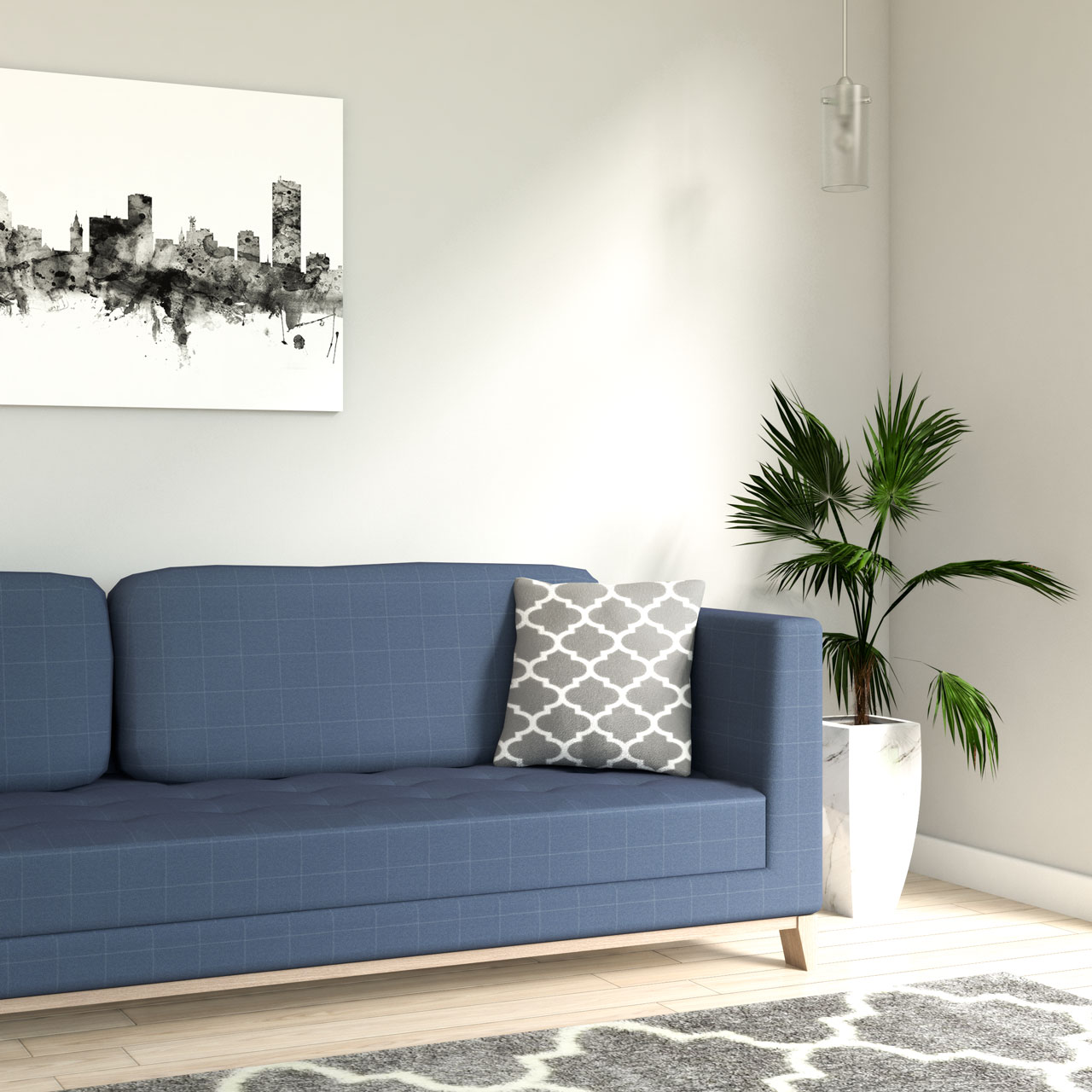 Gray and white geometric throw pillow with blue sofa