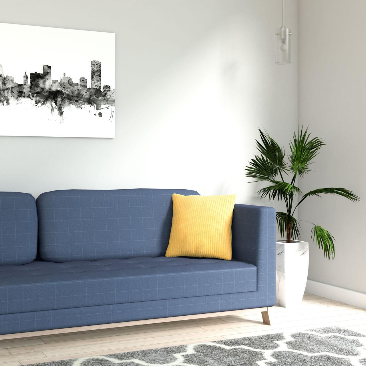 Velvet yellow mustard corduroy throw pillow with blue sofa