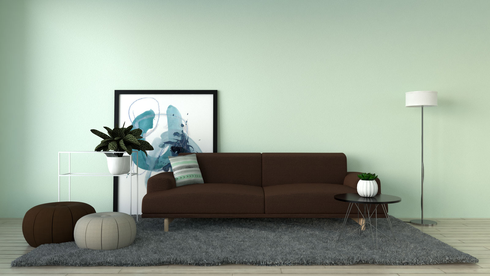 Mint wall with brown sofa