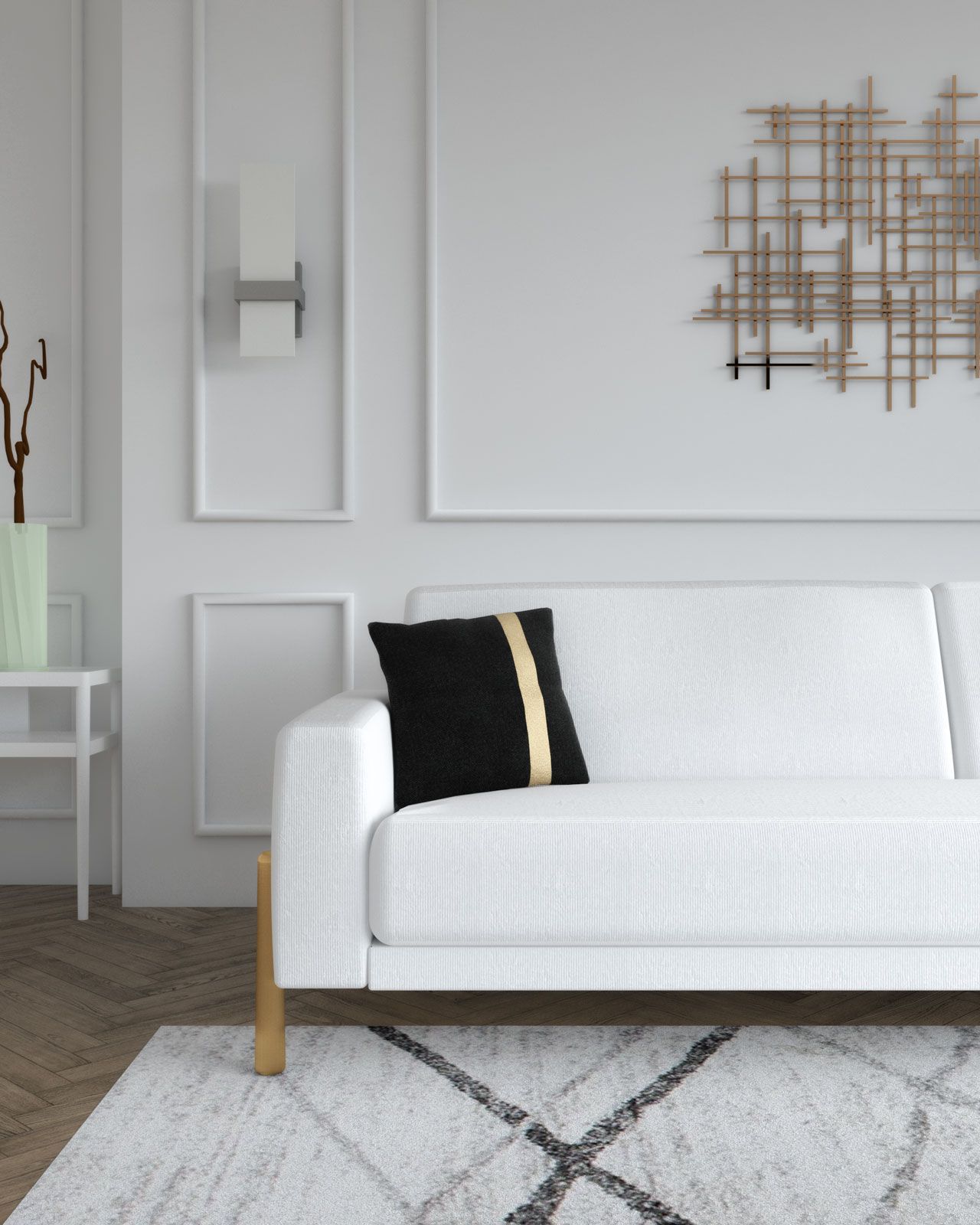 White sofa with black and gold decorative pillow