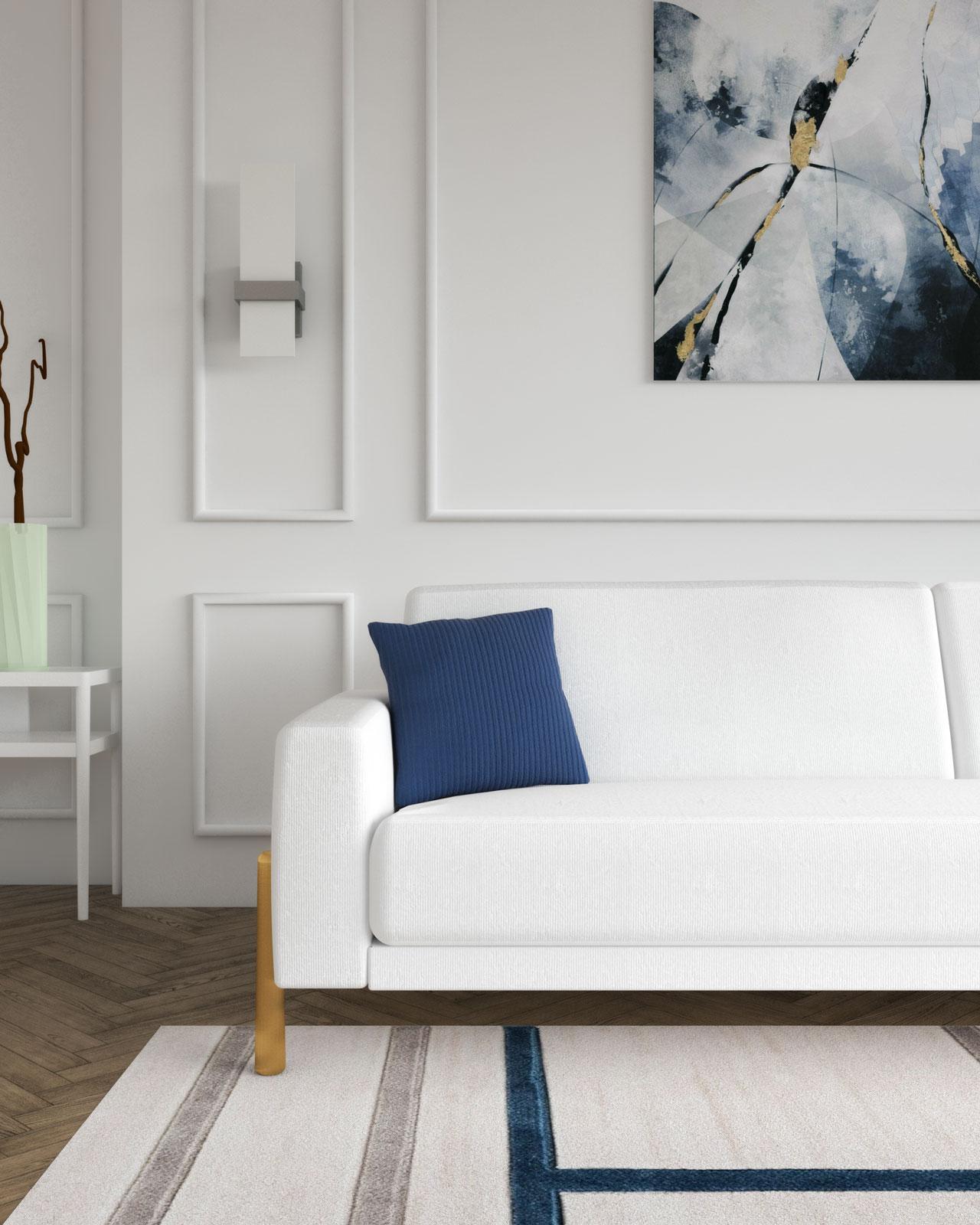 White sofa with navy blue throw pillow
