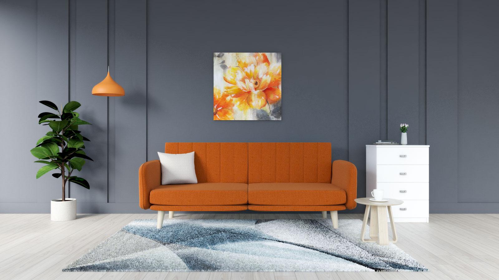 Gray and blue rug with orange sofa