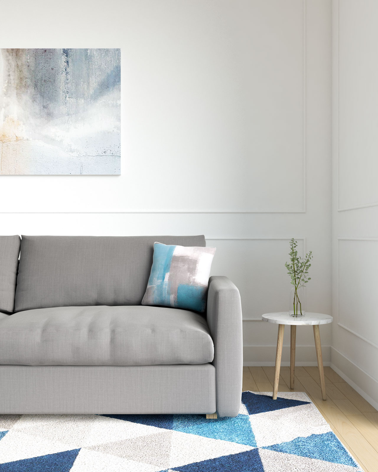 Gray and blue throw pillow with gray sofa