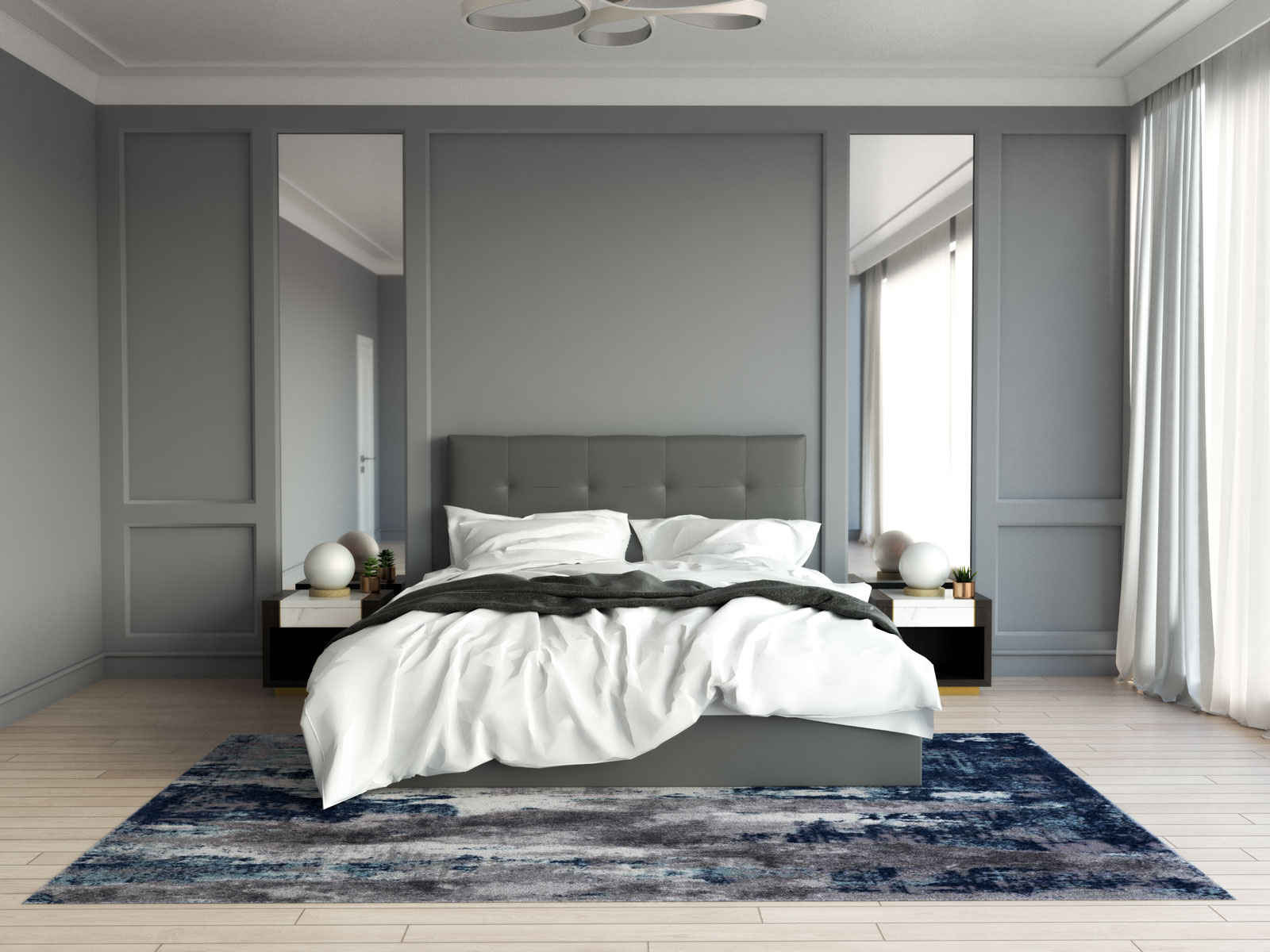 Gray and navy blue rug in bedroom with gray walls