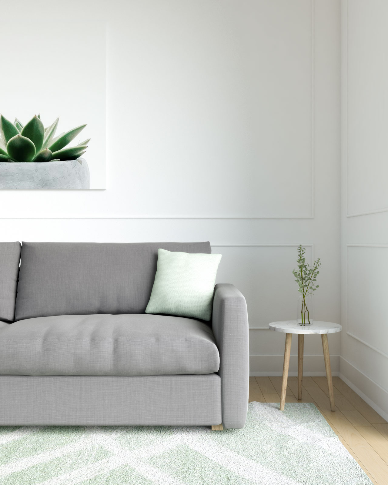 Light green cushion with grey couch