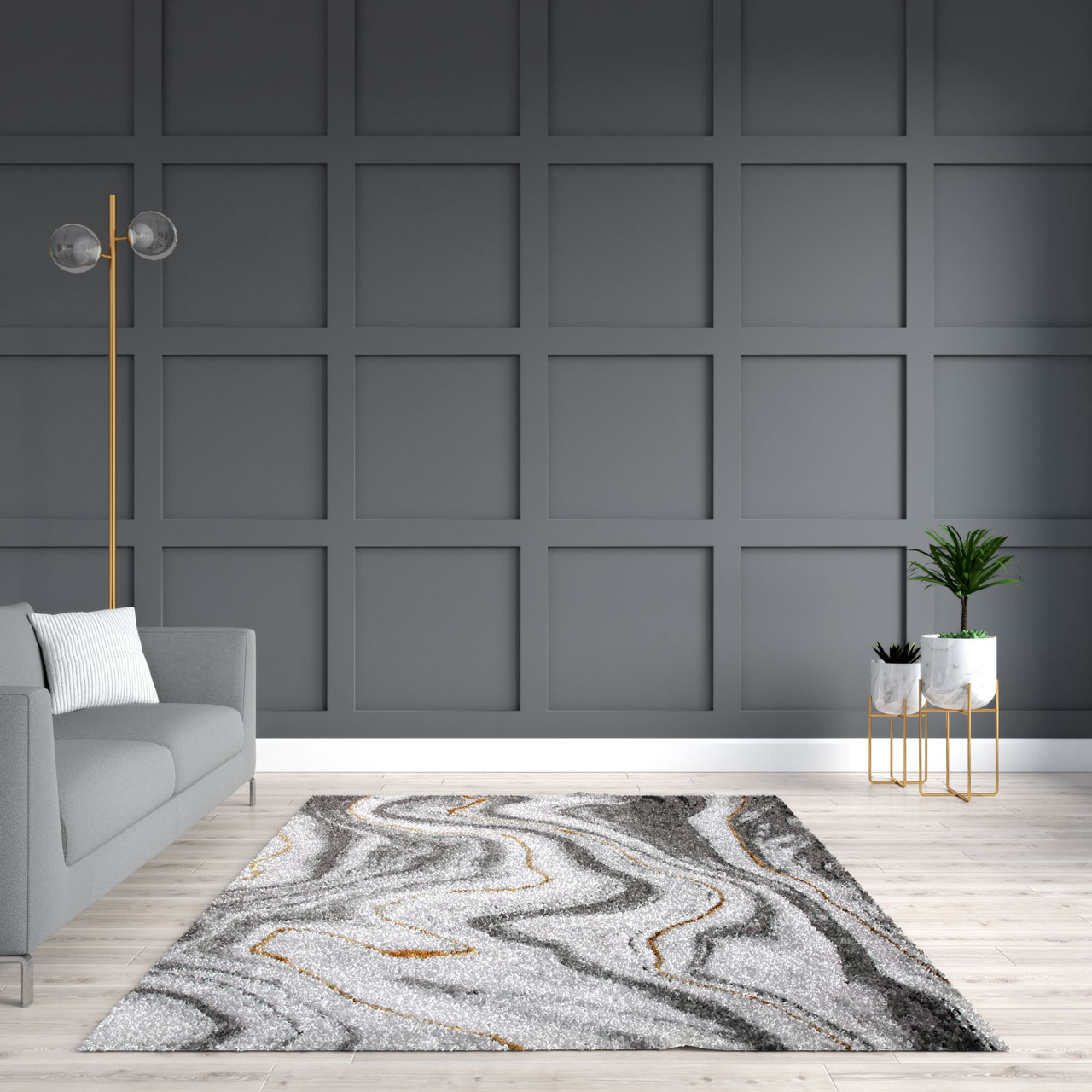 Gray and gold rug in living room with gray wall