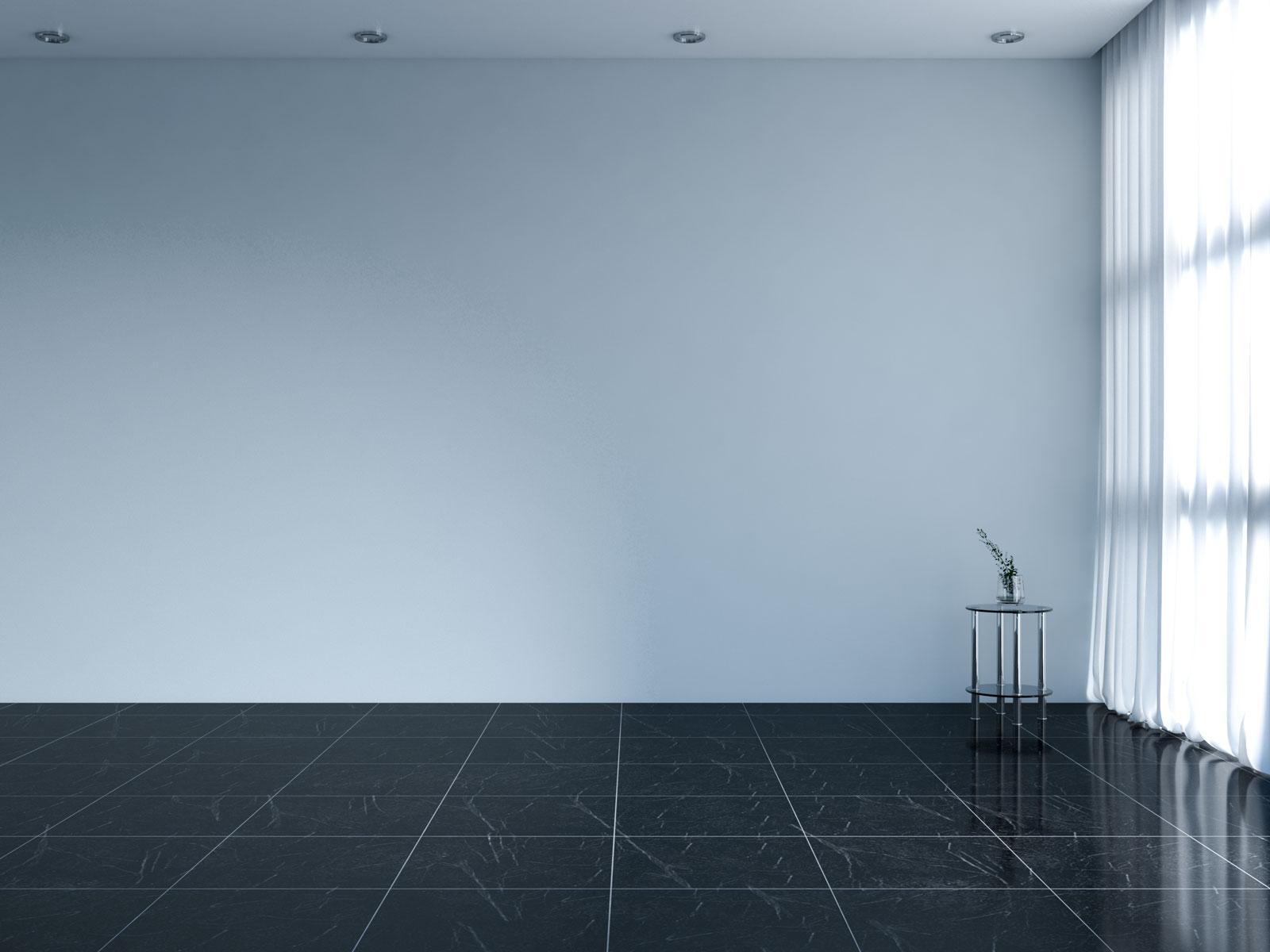 Misty blue wall with black floors