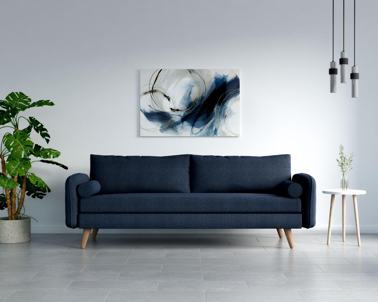 Navy blue sofa with grey tile floors