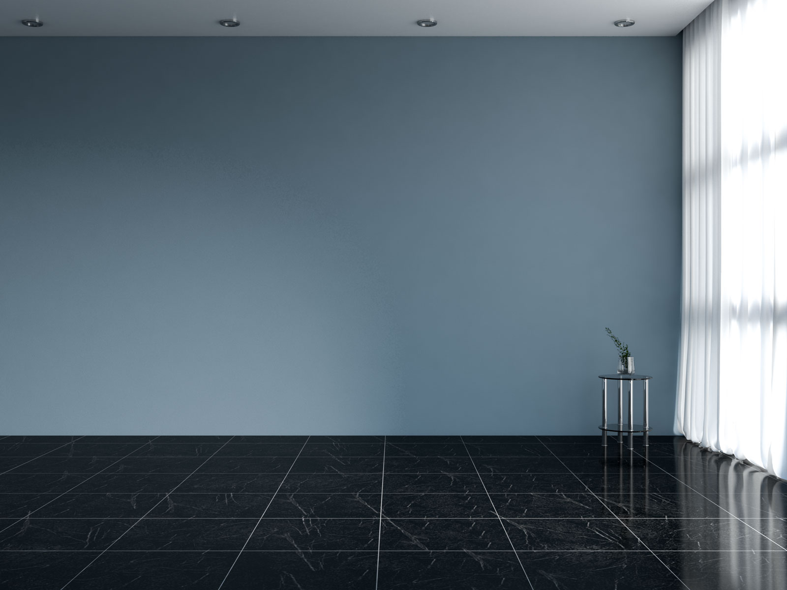 Smoky blue wall with black flooring