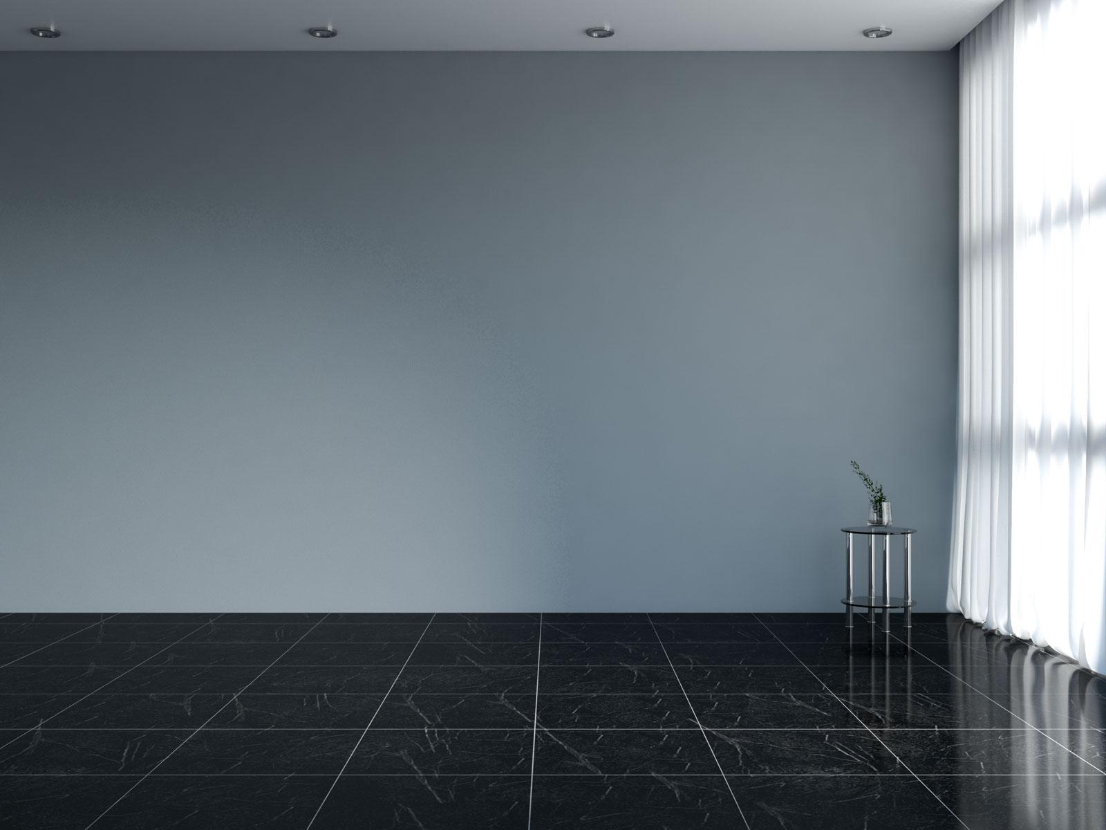 Steel gray wall with black tile floors