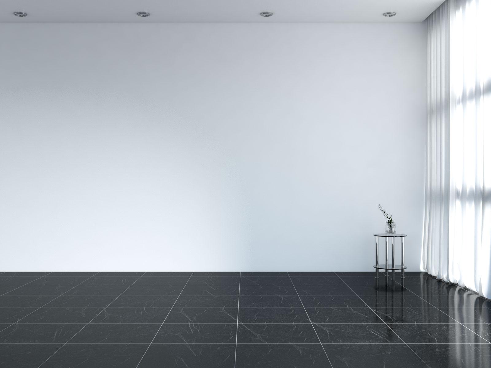 Plain white wall with black floors