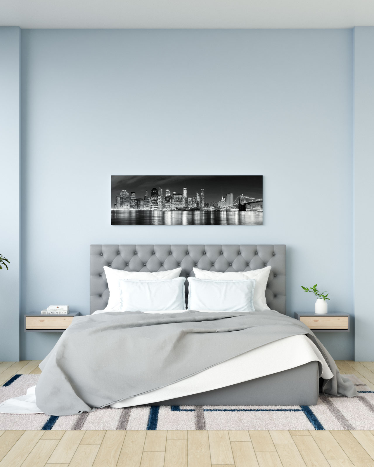 Light blue wall in bedroom with gray bed