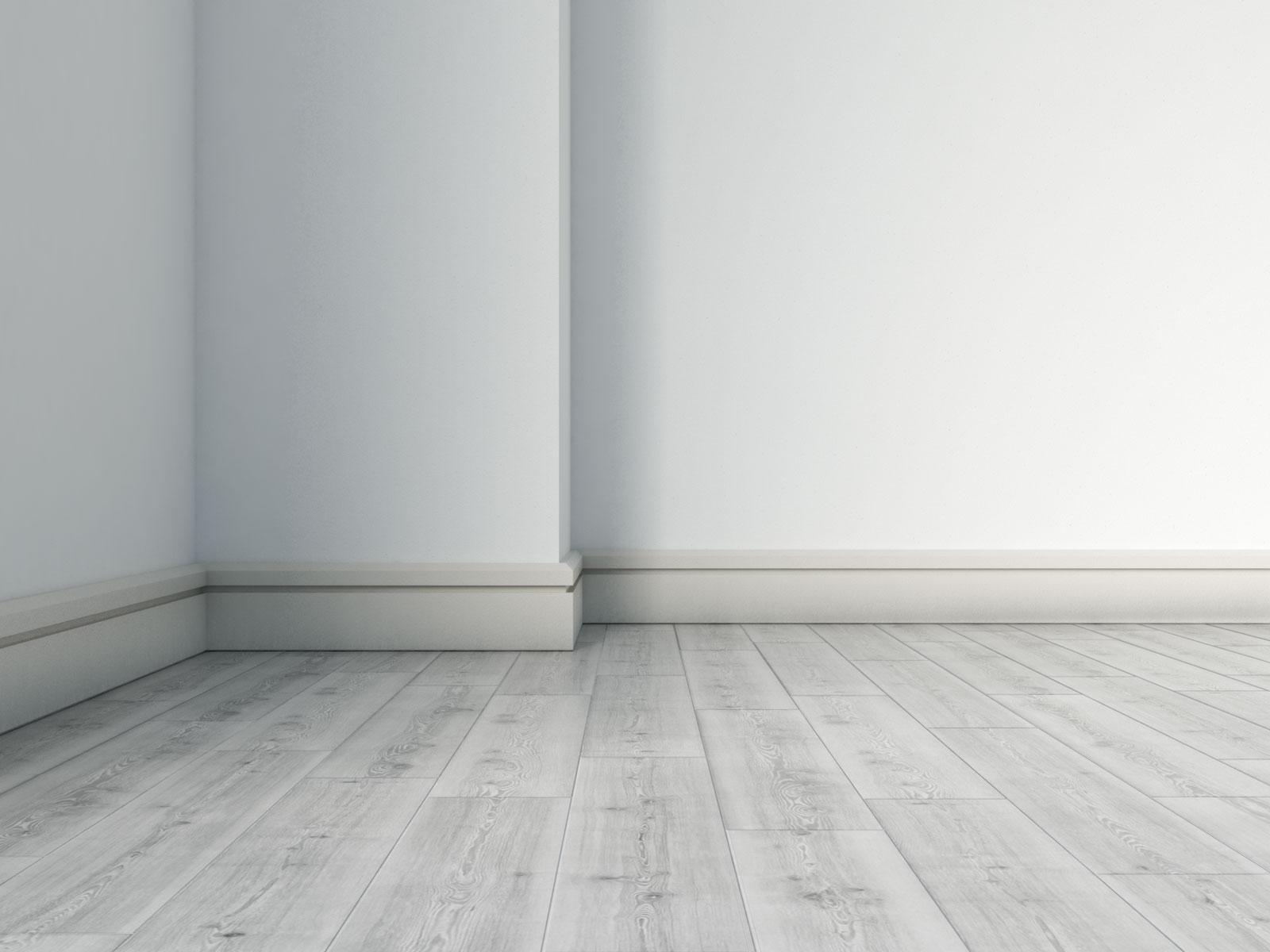 Beige baseboard with gray wood floors