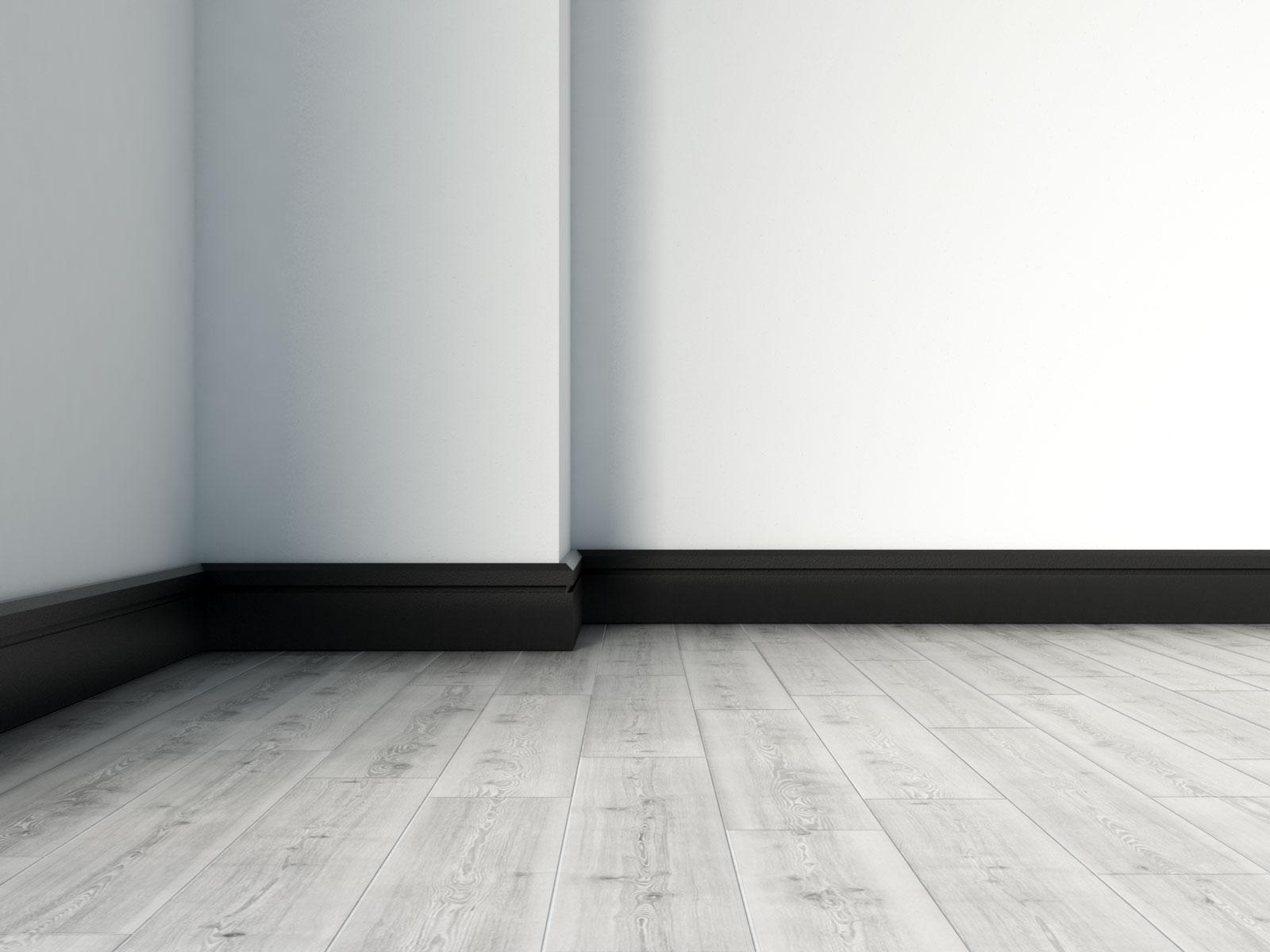 Black baseboard with gray hardwood flooring