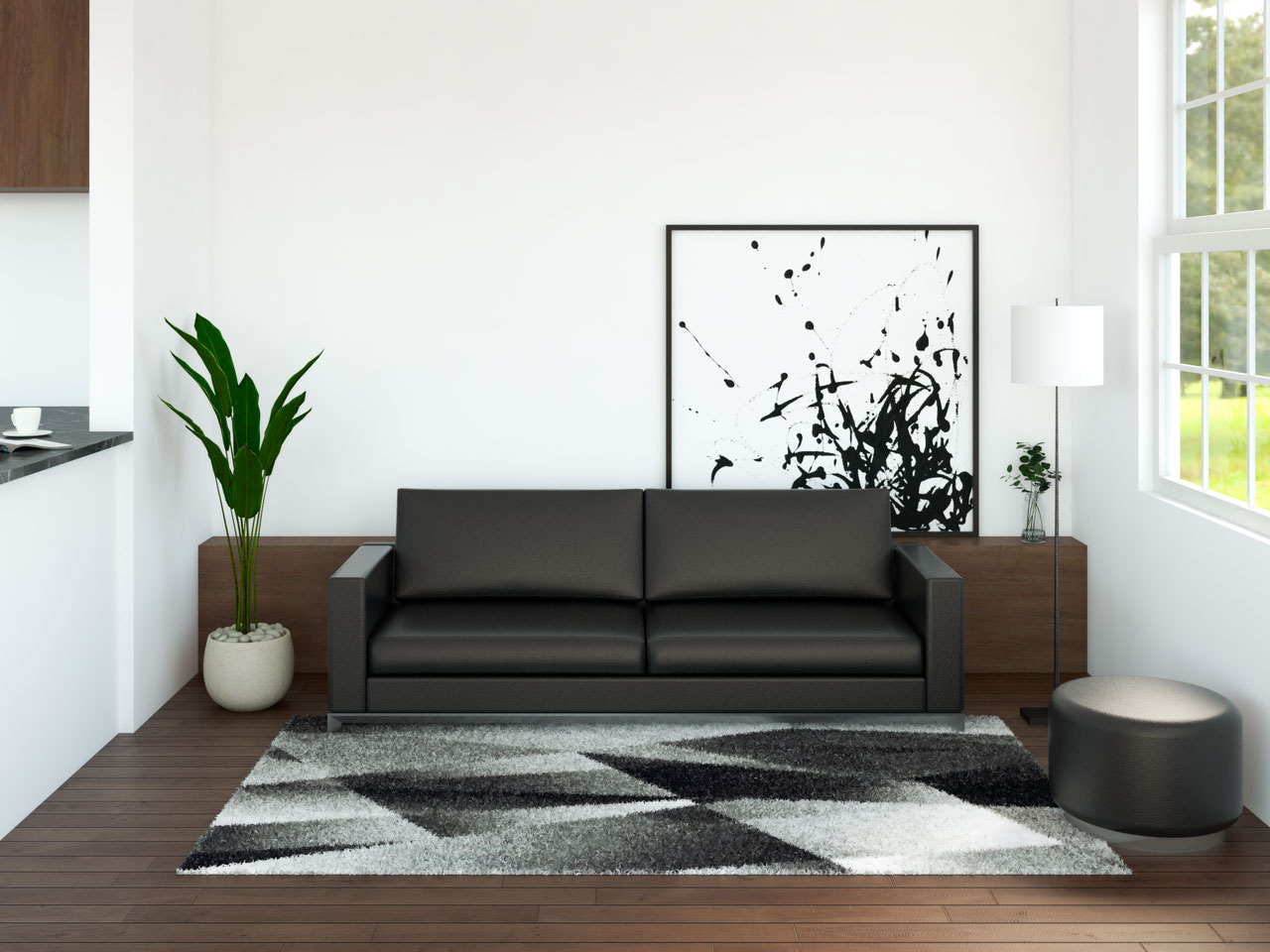Black leather couch with dark wood floors