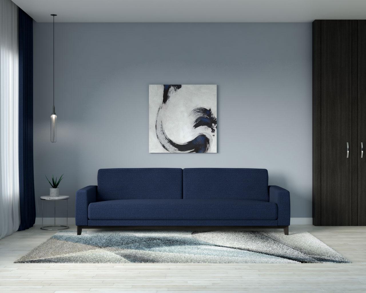 Graysih blue wall with navy sofa