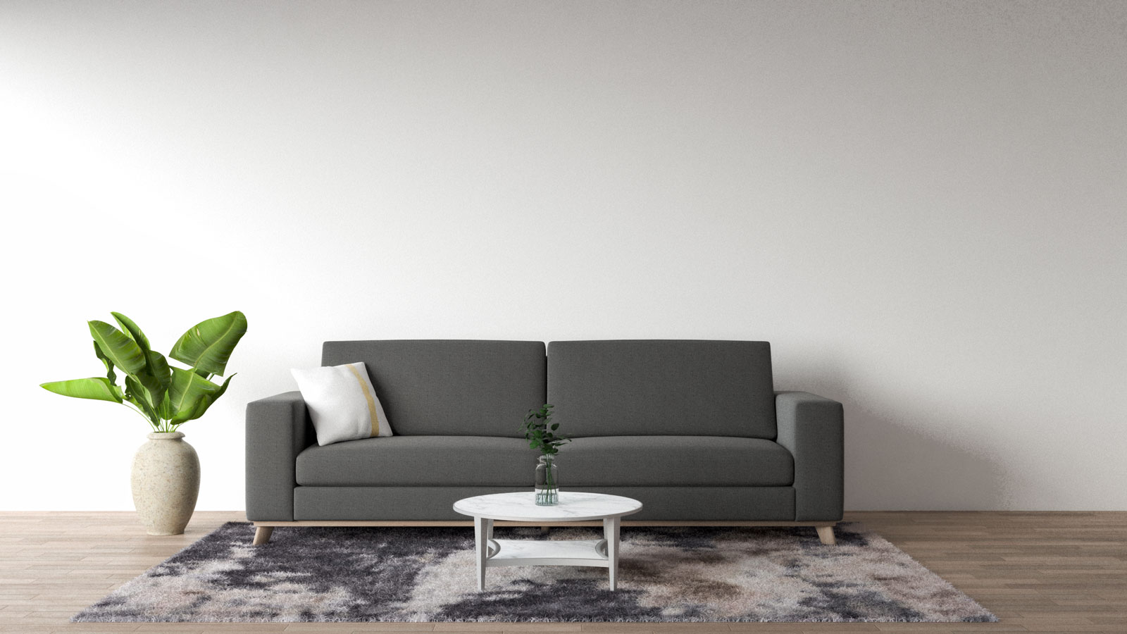 dark gray sofa with white and gold throw pillow