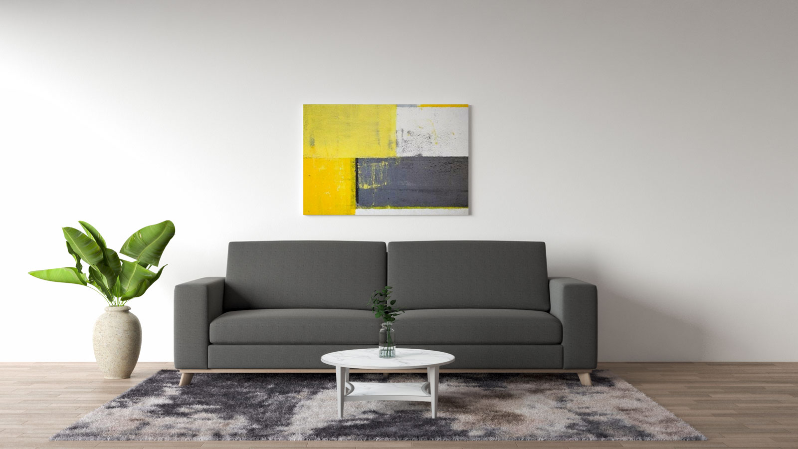 gray couch with yellow wall art