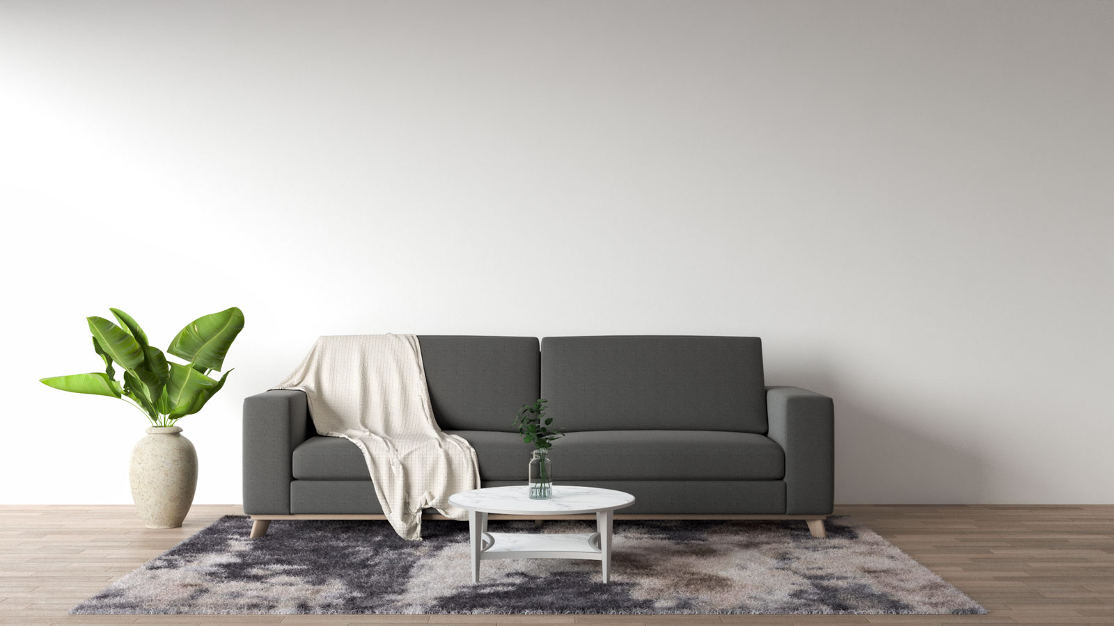 gray couch with cream throw blanket