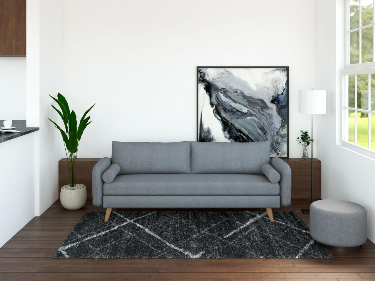Dark gray furniture with dark hardwood flooring