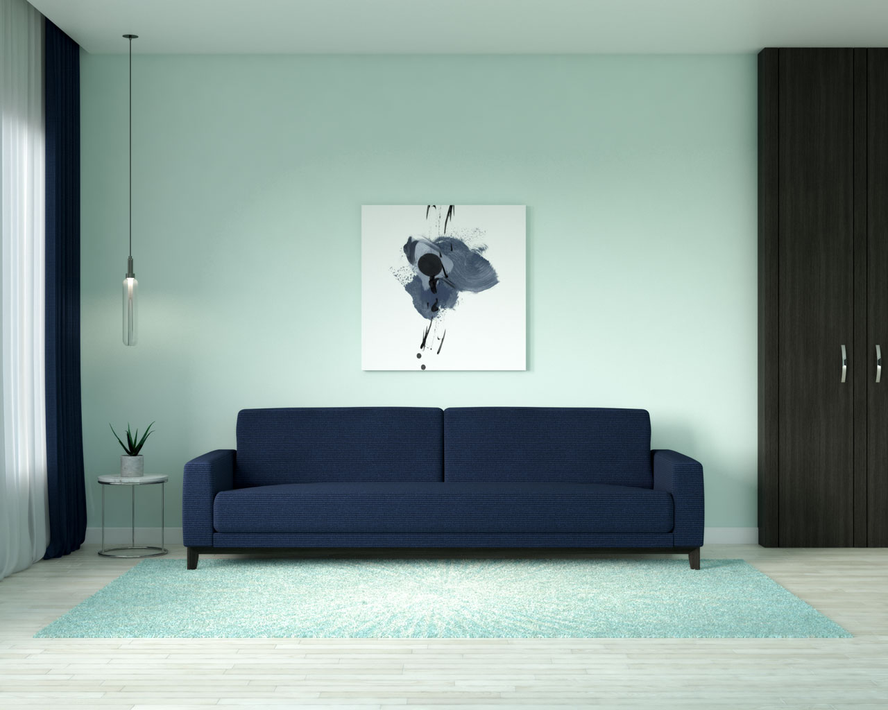 Mint wall with navy sofa
