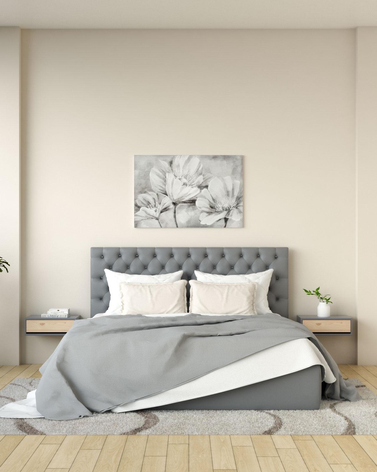 Beige wall with gray headboard