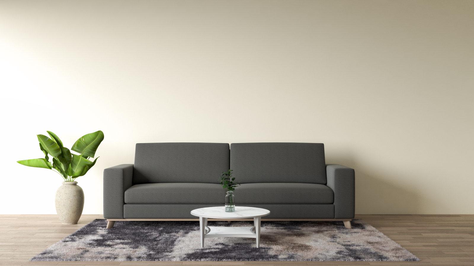 dark gray couches with bright cream walls