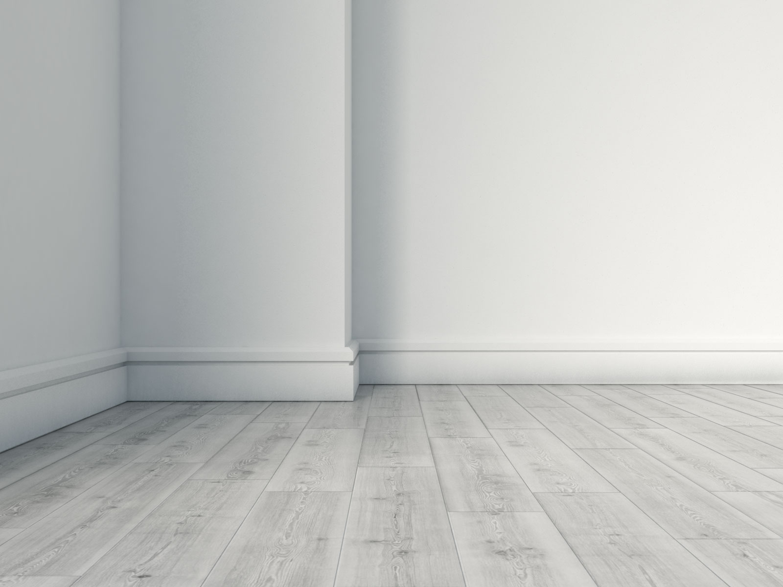 White baseboard with gray flooring