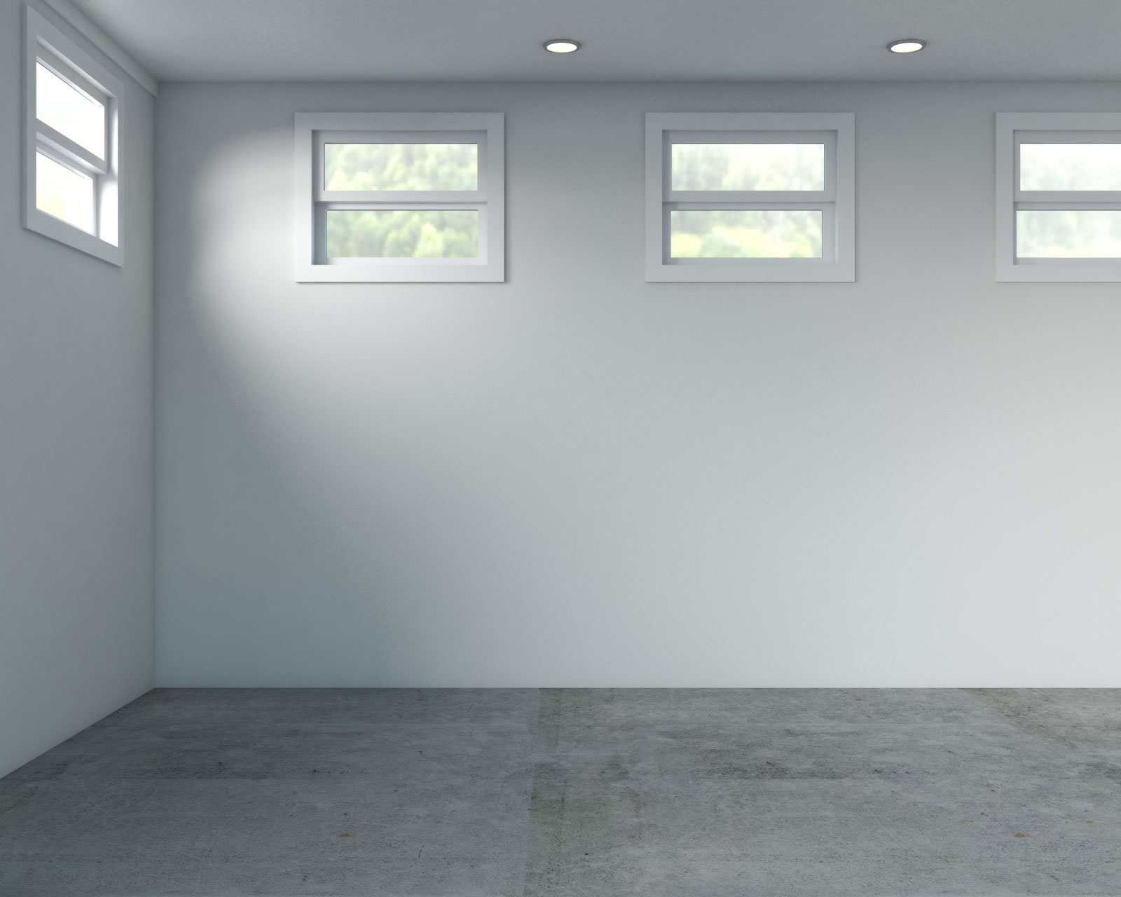 Basement with light gray walls and concrete flooring