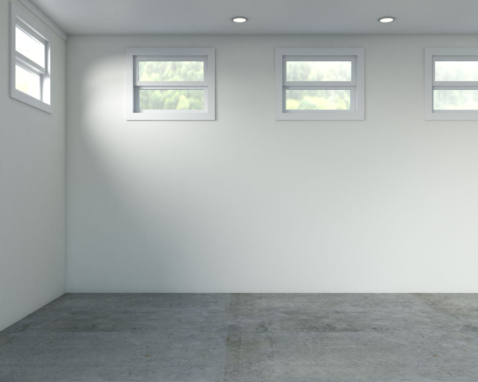 Basement with ivory walls and concrete floors