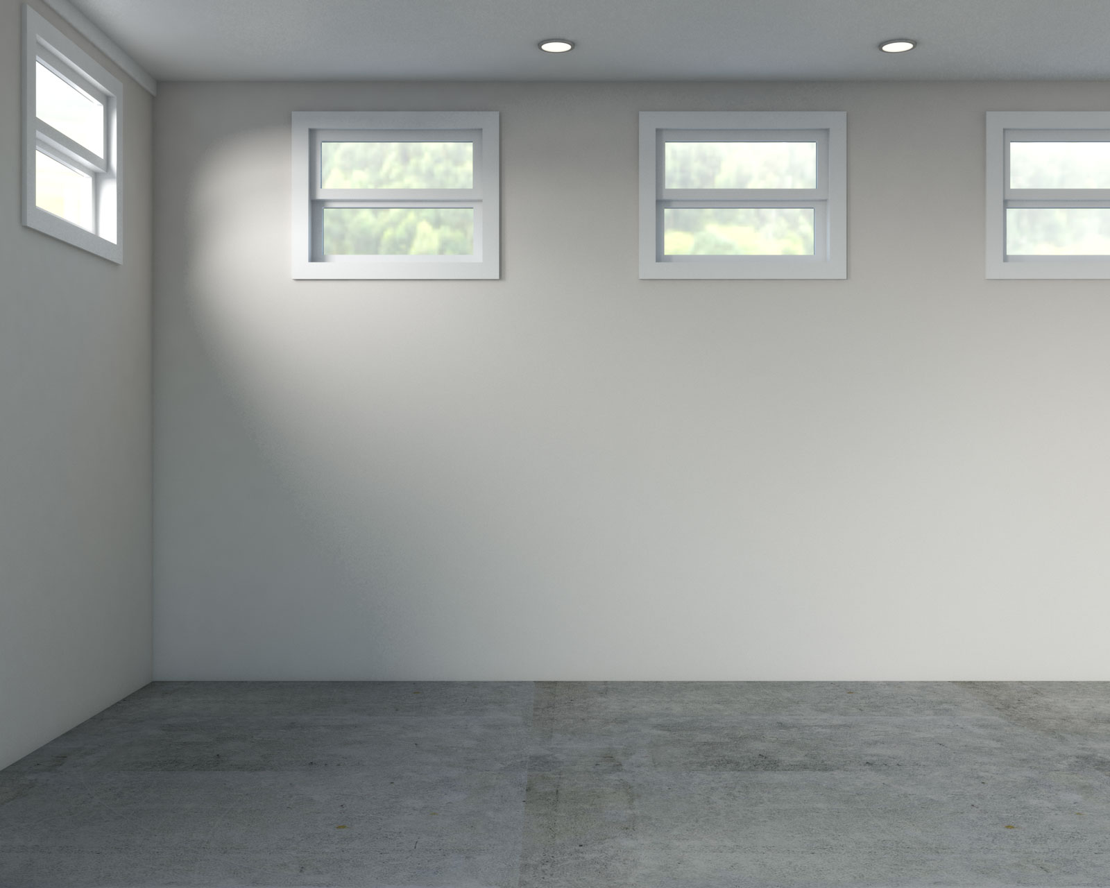 Basement with light brown walls and concrete floor