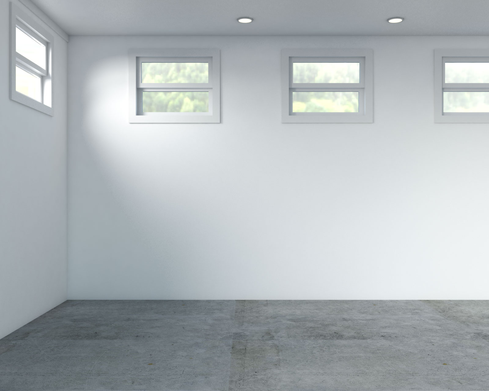 Basement with white walls and concrete flooring
