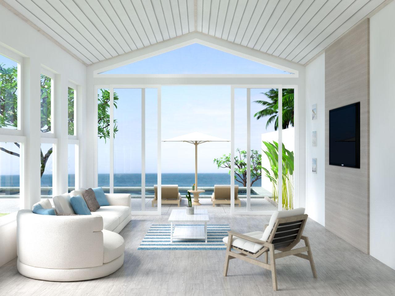 Beach house living room with beige flooring